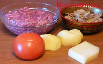 на фото мясной фарш, маринованные грибы, помидор, картофелина и сыр
